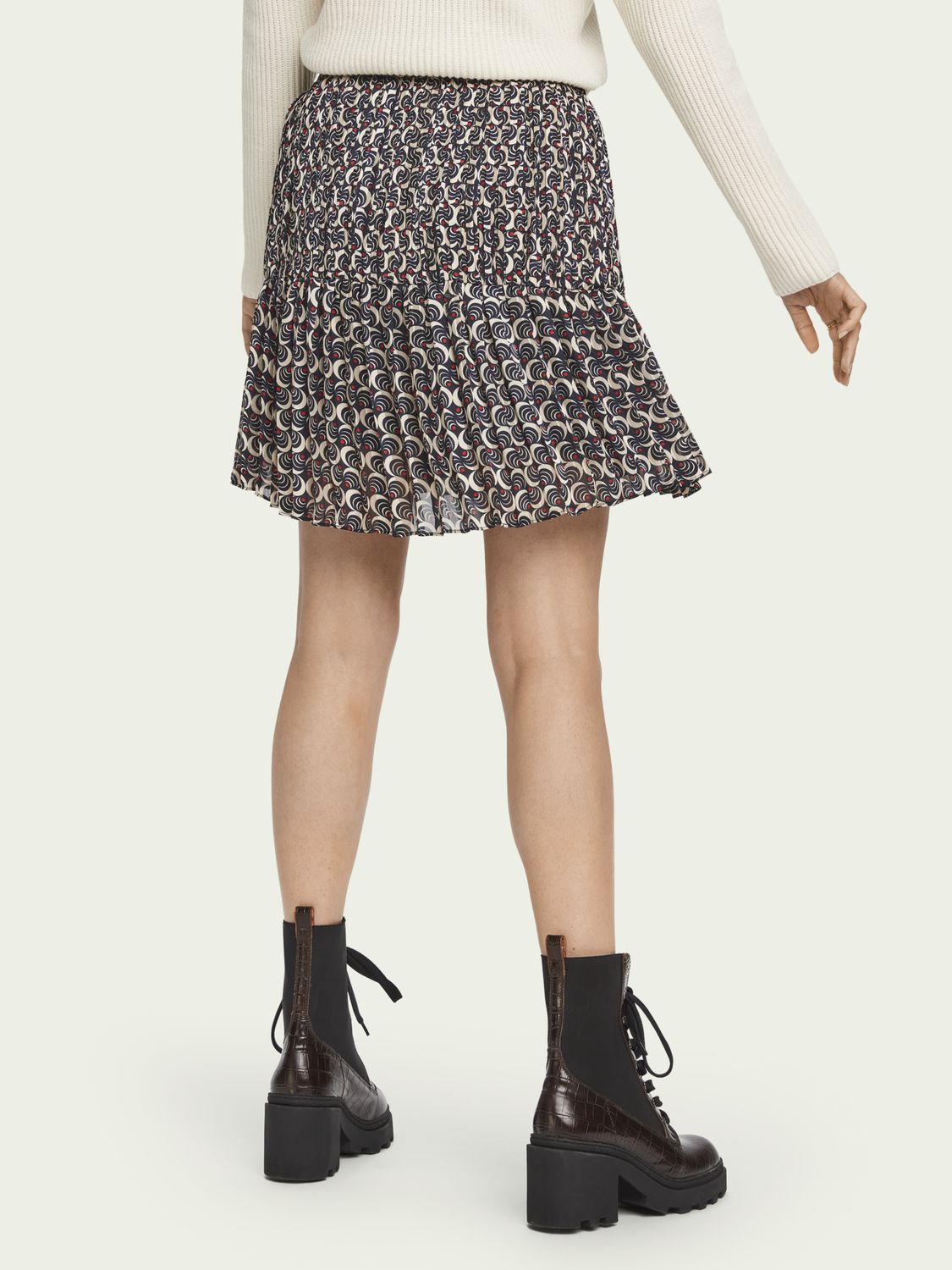 Pleated mini skirt with all-over print